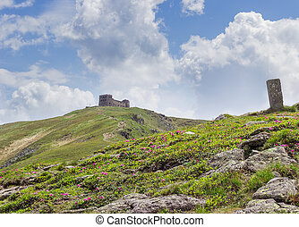Ruins of old observatory on the mountain peak in Carpathians
