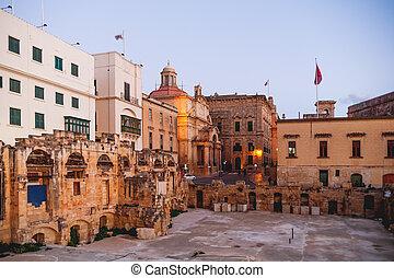 Ruins of Royal Opera theatre. Winter evening in Valletta, Malta.