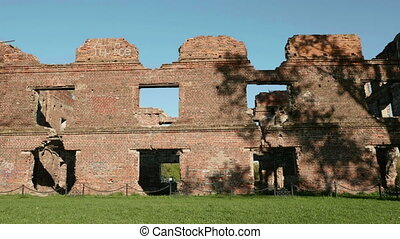 Ruins of the ancient castle. Autumn daytime. Smooth dolly shot