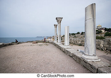 Ruins of the ancient Greek buildings on the Black Sea coast of Russia. Ancient Greek marble columns in Chersonesus Taurica. Sevastopol, Crimea
