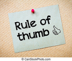 Rule of Thumb Message. Recycled paper note pinned on cork ...