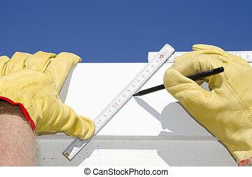 Ruler and pen eith hands of builder outdoor
