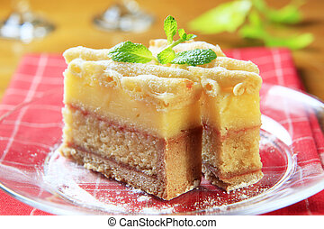 Rum soaked cake - Slice of rum soaked sponge cake with...