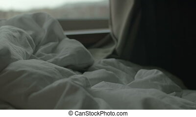 Rumpled blanket on bed in the morning - Morning scene with...