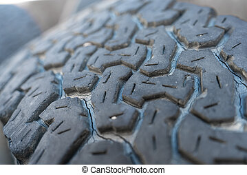 Run-down 4x4 tire closeup view with shallow depth of field...