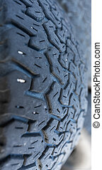 Run-down 4x4 tire detailed view with shallow depth of field...