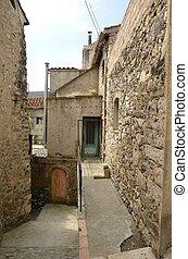 Run-down alley in Besalu, a medieval town of Girona, ...
