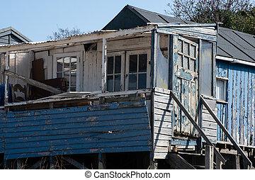 Run down blue wooden coastal home - Run down blue wooden...