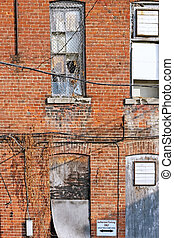 Run down Building exterior with old broken windows