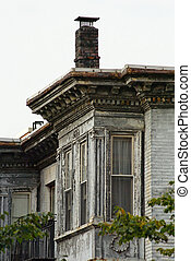 run down building - Stately old apartment building in...