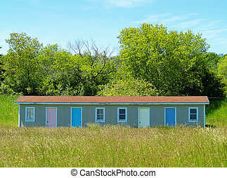 run-down motel - old motel with multi-colored doors