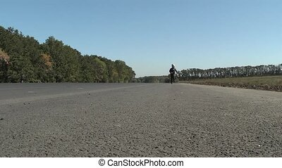 run - small boy runs on road