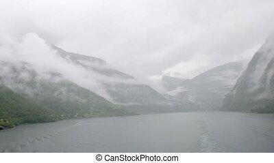 Run through beautiful misty fjord, time lapse