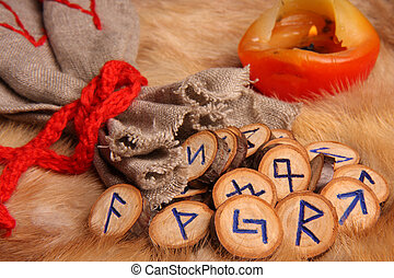 Runes with pouch and candle close-up - Runes with pouch and...