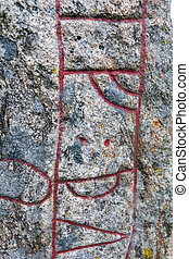 Runestone on a the field with runic inscription, runes about 1000 A.D.