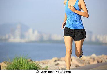 Runner athlete running at seaside city