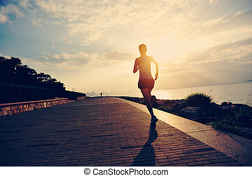 Runner athlete running at seaside. woman fitness silhouette ...