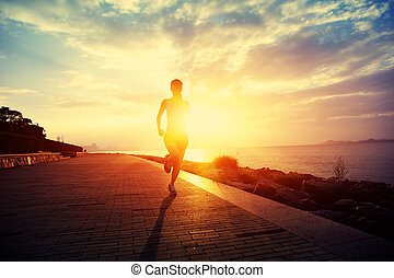 Runner athlete running at seaside. woman fitness silhouette...