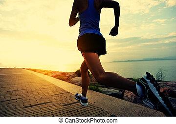 Runner athlete running at seaside. woman fitness silhouette...