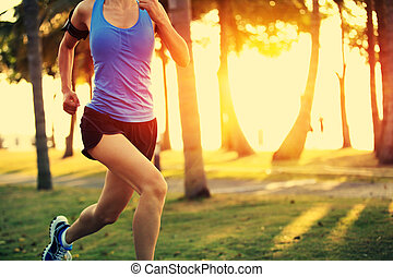 Runner athlete running at tropical park. woman fitness ...