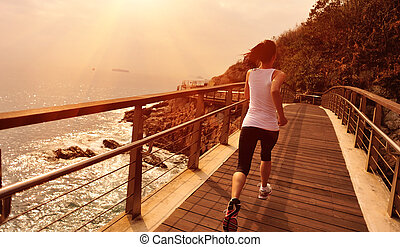 Runner athlete running on boardwalk