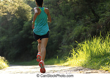 Runner athlete running on forest trail. woman fitness ...