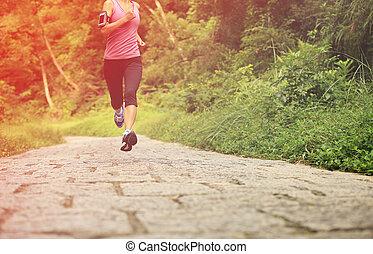 Runner athlete running on forest