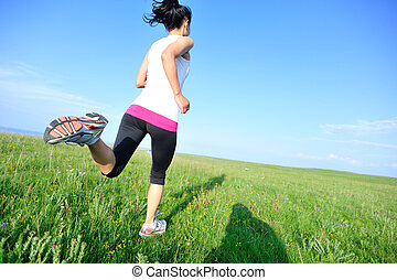 Runner athlete running on grass - Runner athlete running on...