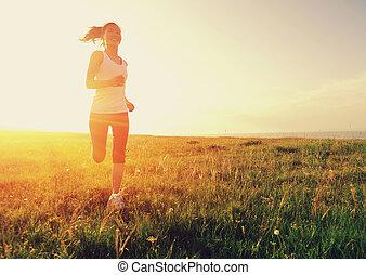 Runner athlete running on grass seaside. woman fitness...
