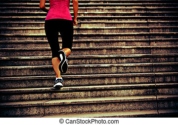 Runner athlete running on stairs - Runner athlete running on...
