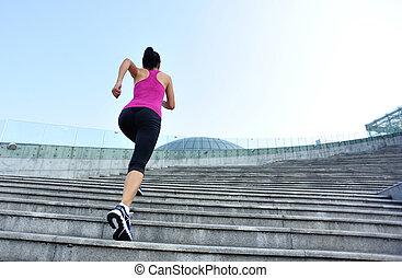 Runner athlete running on stairs. - Runner athlete running...