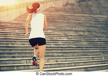 Runner athlete running on stairs. woman fitness jogging ...