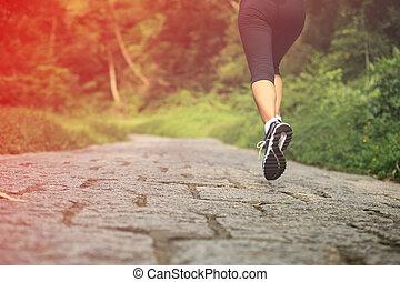 Runner athlete running on trail