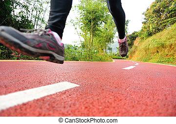 Runner athlete running on trail.