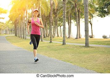 Runner athlete running - Runner athlete running at tropical...