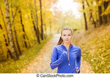 Runner - Beautiful running woman jogging in autumn nature
