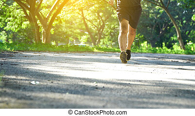 Runner feet running on road.