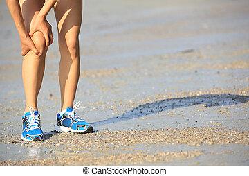 runner hold sports injured knee