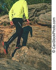 Runner in yellow green shinning jacket and black leggings