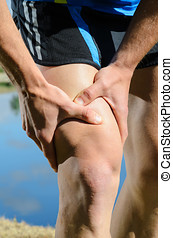 Runner Injury - Runner feels muscle pain and grabs the leg.