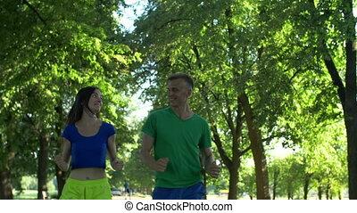 Runner man flirting with woman during jogging