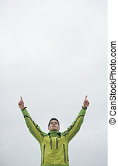 Runner man with arms raised in victory symbol