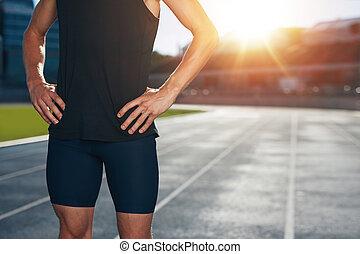 Runner on athletics running track