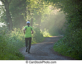 Runner on Footpath - Woman Runner on footpath in countryside