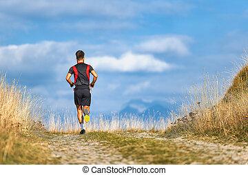 Runner on mountain road trains for a high altitude marathon