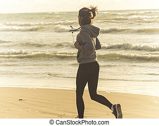 runner on the sea beach