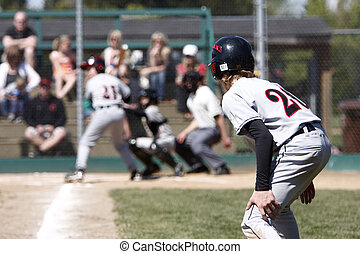 Runner on third ready to run for home plate.