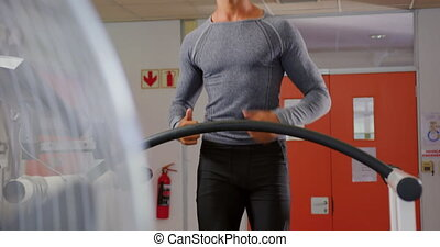 Runner on treadmill - Front view of a young mixed race man ...