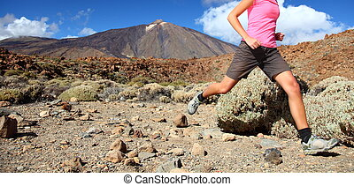 Runner - Running in spectacular volcano landscape on Teide, ...