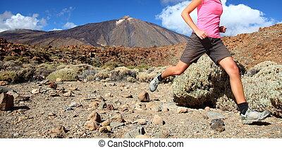 Runner - Running in spectacular volcano landscape on Teide, ...
